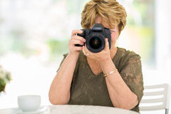 Senior woman shooting pictures Stock Image
