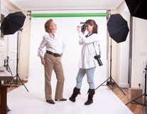 Senior woman in shooting session Royalty Free Stock Photos