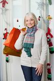 Senior Woman With Shopping Bags During Christmas Stock Image