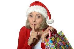 Senior woman with shopping bags Stock Photos