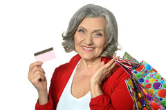 Senior woman with shopping bags Royalty Free Stock Photos