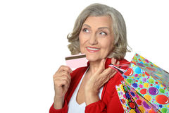 Senior woman with shopping bags Stock Photo