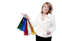 Senior woman with shopping bags Stock Photography