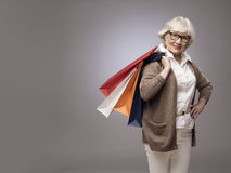 Senior woman with shopping bags royalty free stock image