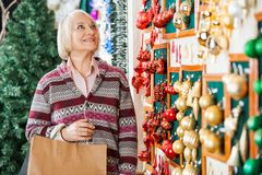 Senior Woman Shopping Christmas Ornaments Stock Photos