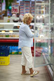 Senior woman shopping for dairy products Royalty Free Stock Image