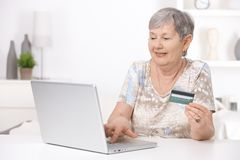 Senior woman shopping on internet Royalty Free Stock Image
