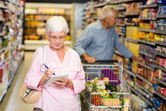 Senior woman with shopping list Royalty Free Stock Image