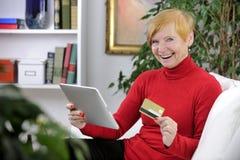 Senior woman shopping online stock image