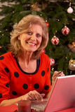 Senior Woman Shopping Online For Christmas Gifts. Smiling Stock Image
