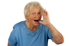 Senior woman is shouting loud. On white background royalty free stock photo