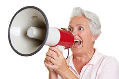 Senior woman shouting in megaphone Royalty Free Stock Photo