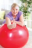 Senior woman shoving thumb up Royalty Free Stock Photo
