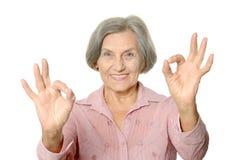 Senior woman show Stock Photo