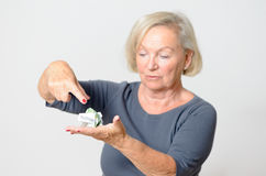 Senior Woman Showing Crumpled Money on Hand Stock Images