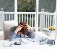 Senior woman showing depression while working on her financial m royalty free stock photo