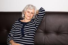 A  senior woman showing that she enjoys retirement. Royalty Free Stock Photos