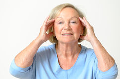 Senior woman showing her face, effect of aging Stock Photos