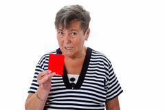 Senior woman showing red card Stock Photo