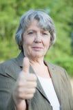 Senior woman showing thumbs up Stock Photos