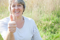 Senior woman showing thumbs up Royalty Free Stock Image
