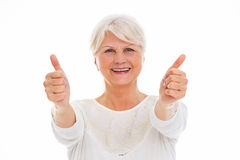 Senior woman showing thumbs up Royalty Free Stock Images