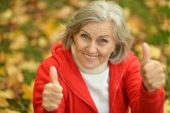 Senior woman showing Stock Image