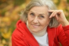 Senior woman showing Stock Photo