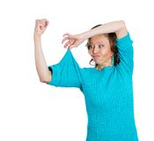 Senior woman showing up her muscles Stock Images