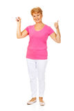 Senior woman shows thermometer and gesturing OK Stock Photo