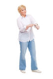 Senior woman shows the watch Royalty Free Stock Photography