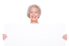 Senior woman with sign Stock Photos