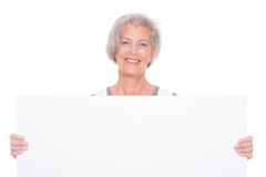 Senior woman with sign Royalty Free Stock Images