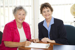 Senior Woman Signing Paperwork Royalty Free Stock Image
