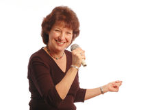 senior woman singing Microphone in hand  Stock Image