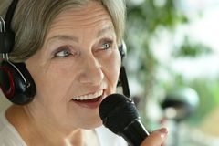 Senior woman singing Stock Photography