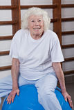 Senior Woman Sits on a Fitball Stock Photo
