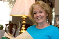 Senior Woman Reading Stock Image