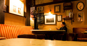 Senior woman sitting alone in a cafe Royalty Free Stock Image
