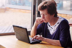 Senior woman sitting on the cafe Royalty Free Stock Photos