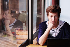 Senior woman sitting on the cafe Stock Photo