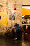 Senior woman sitting in a chair reading news paper at Chelsea Market in New York City. Dec 29, 2016 : Senior woman sitting in a chair reading news paper at royalty free stock photo