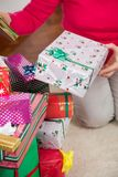 Senior Woman Sitting By Christmas Gifts Royalty Free Stock Photos