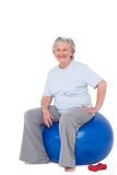 Senior woman sitting on exercise ball Stock Photos