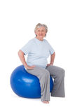 Senior woman sitting on exercise ball Royalty Free Stock Photography