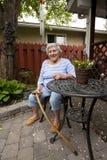 Senior Woman Sitting in Garden royalty free stock photos
