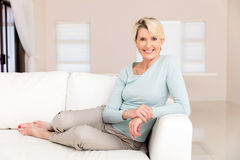 Senior woman sitting home Stock Images