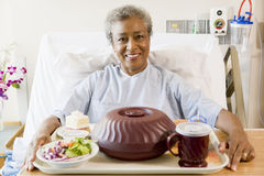 Senior Woman Sitting In Hospital Bed Royalty Free Stock Image