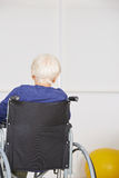 Senior woman sitting lonely in wheelchair Stock Images