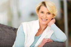Senior woman sitting royalty free stock photography